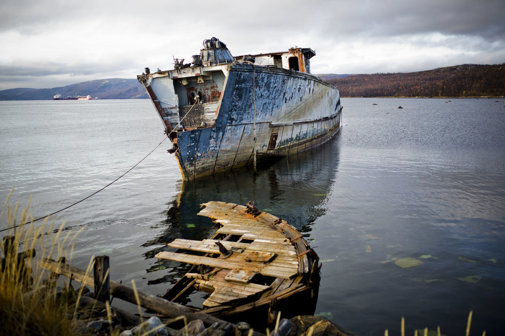 An abandoned ship rests in waters of Kola Bay, Russia. October 9, 2013