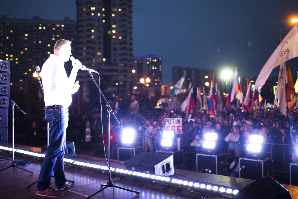 Russian opposition leader Alexey Navalny speaks at a rally in Moscow district Maryino, where an opposition rally was replaced by the city administration in September 2015