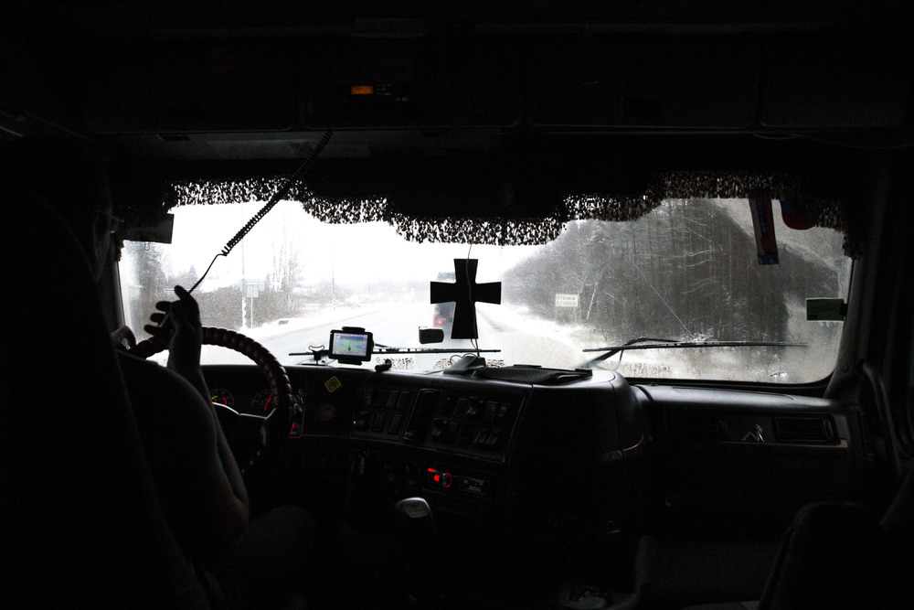 A truck driver heads to Moscow to participate in a protest against new tax on his business. December 2015