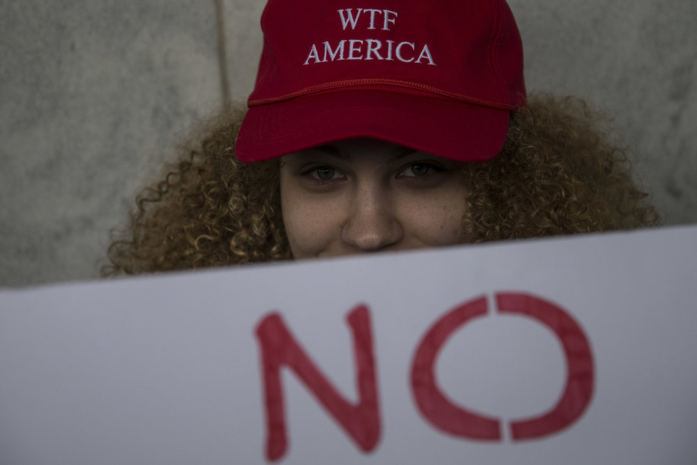 A Women's March on Washington participator looks into camera