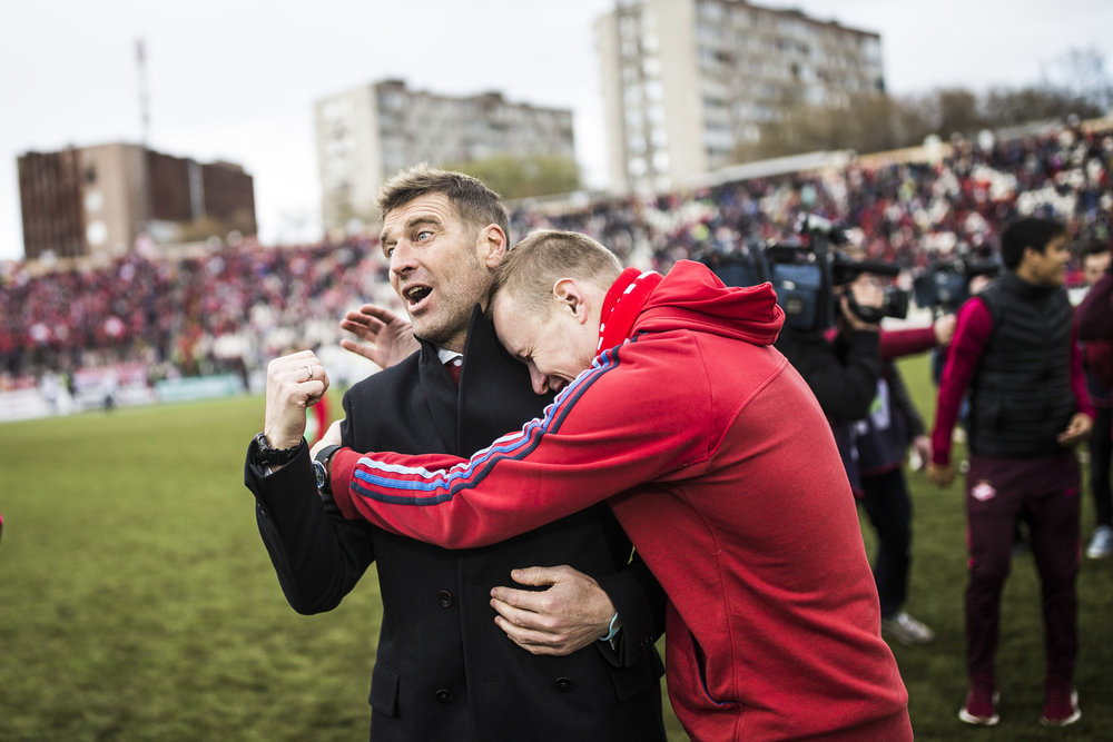 Spartak Moscow fan, who ran off the stands onto the pitch, hugs team's head coach Massimo Carrera after a league game in Perm. A few days ago Spartak became the league champion for the first time in 16 years. May 13th, 2017