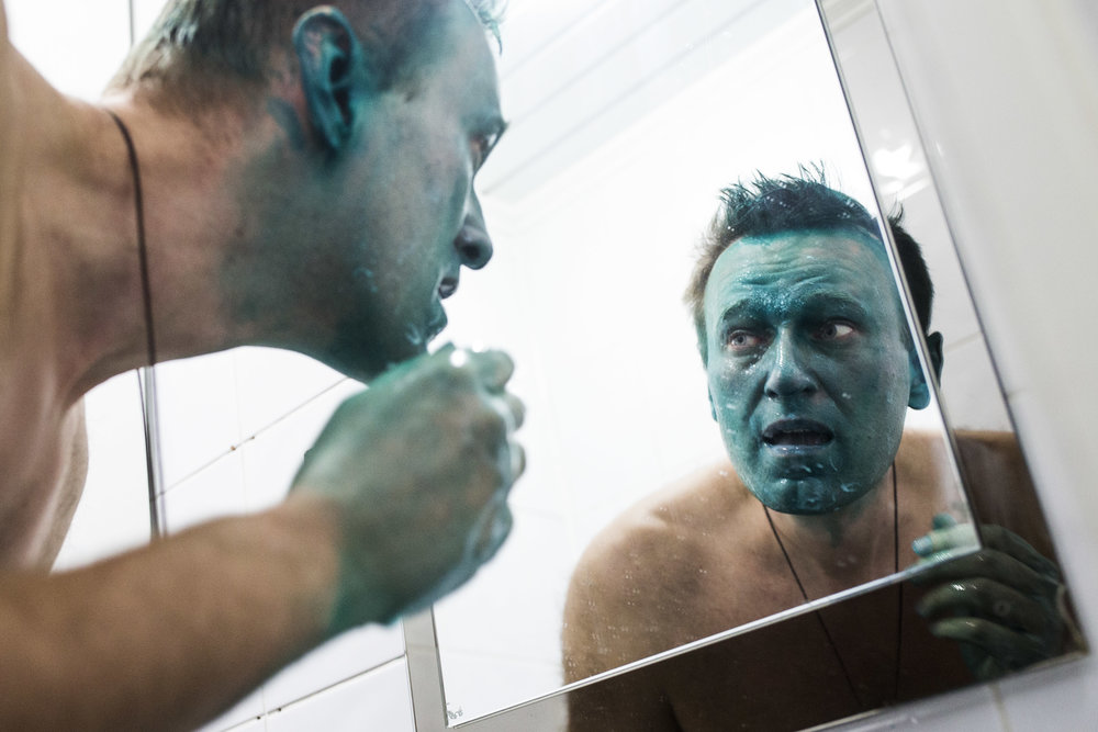 Alexey Navalny, frightened, looks in the mirror at his presidential campaign�s office in Barnaul in Siberia after he was attacked with a caustic green liquid at doorsteps by a man believed to have ties with local government