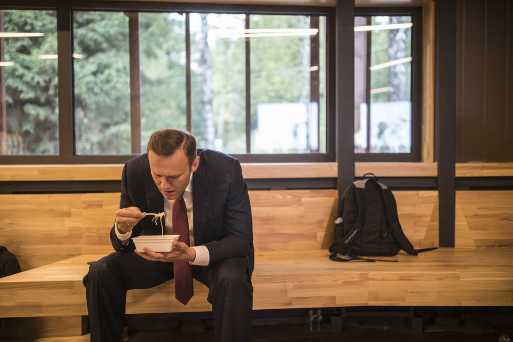 Alexey Navalny eats noodles in the backstage of his campaign's staff meeting in Tarusa, Russia