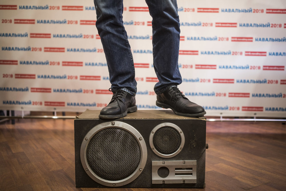 Alexey Navalny speaks to his campaign's volunteers in Cherepovets, Russia while standing on a vintage loudspeaker