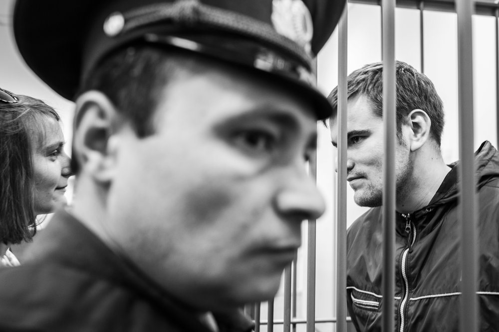 Anna & Alexey Gaskarov look at each other as he is arrested for confronting police on a rally. Gaskarov was sentenced to 3,5 years in jail and is still imprisoned. April 29, 2014
