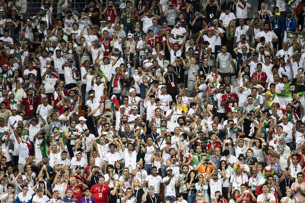 Iranian fans are seen on the last minutes of a nail-biting draw game against Portugal in Saransk