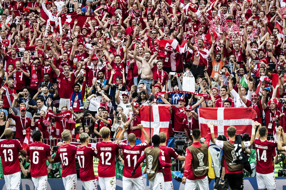 Danish fans celebrate with their team as it passed into play off stage of the World Cup after a draw versus France in Moscow