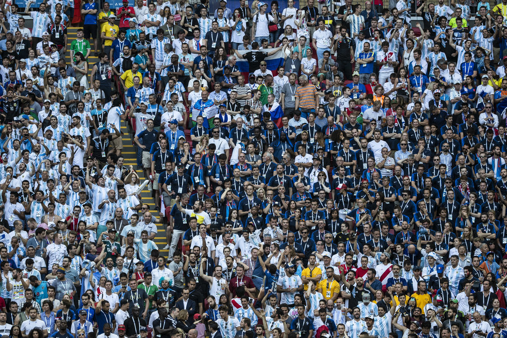 Argentinians celebrate their second goal as they surround saddened French supporters in Kazan