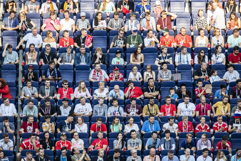VIP stand attendees are watching the bronze medals game in Saint Petersburg