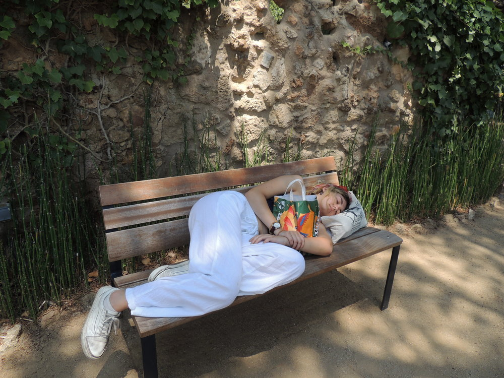 A museum-fatigued Emme asleep on a bench in Barcelona. July 2018