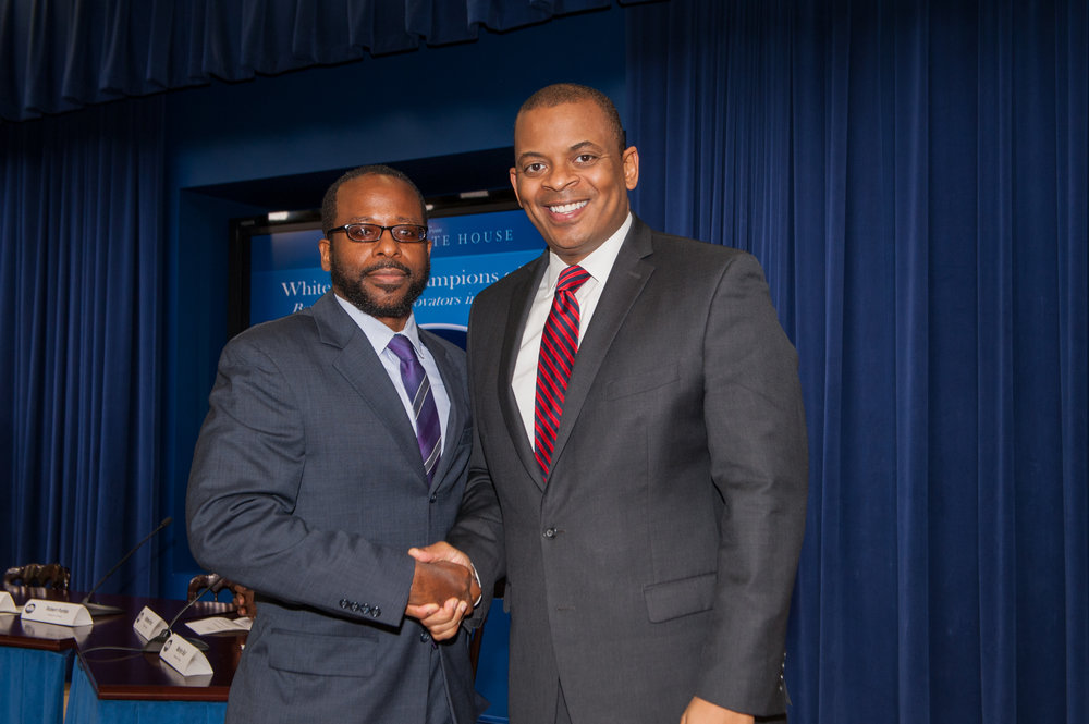 Oboi Reed at The White House, accepting The 2015 White House Transportation Champion of Change Award from former U.S. Department of Transportation Secretary Anthony Foxx.