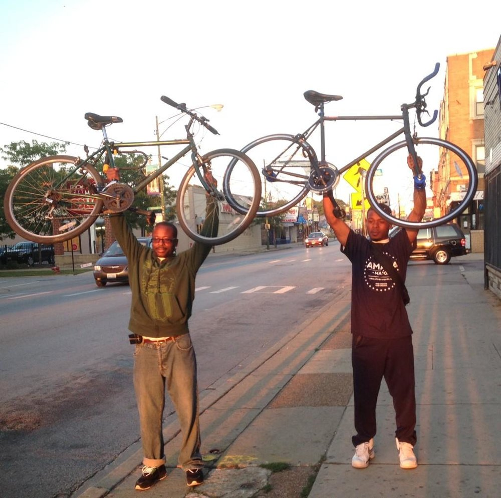 Oboi (left) with Slow Roll Chicago Co-Founder Jamal Julien.