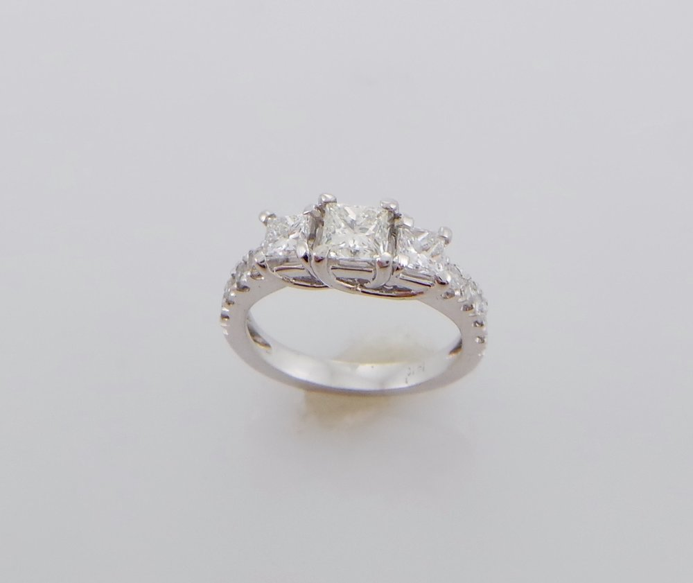Three stone princess cut diamond engagement ring