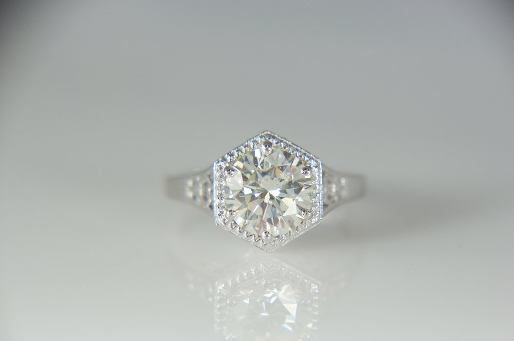 Antique style solitaire engagement ring