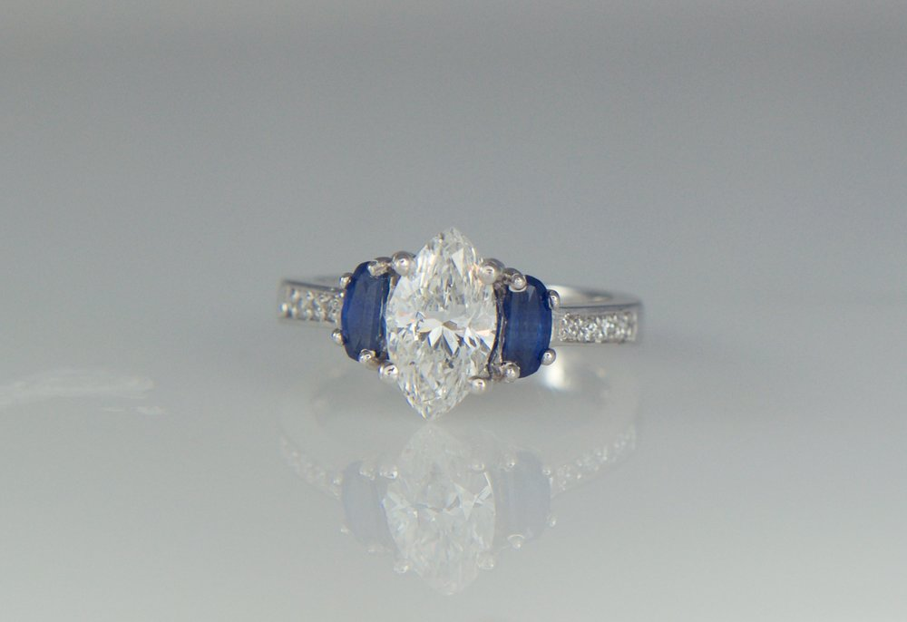Marquis diamond engagement ring with sapphires