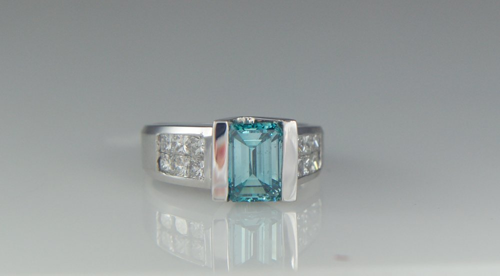 Blue Emerald cut diamond engagement ring