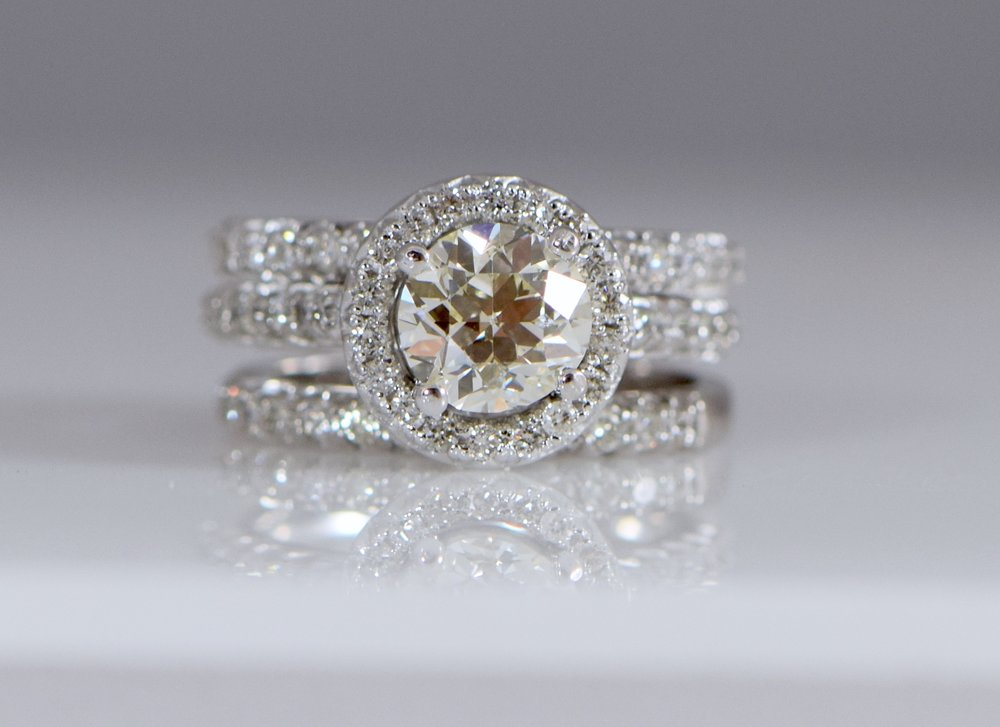 Three ring Round Brilliant diamond halo engagement ring