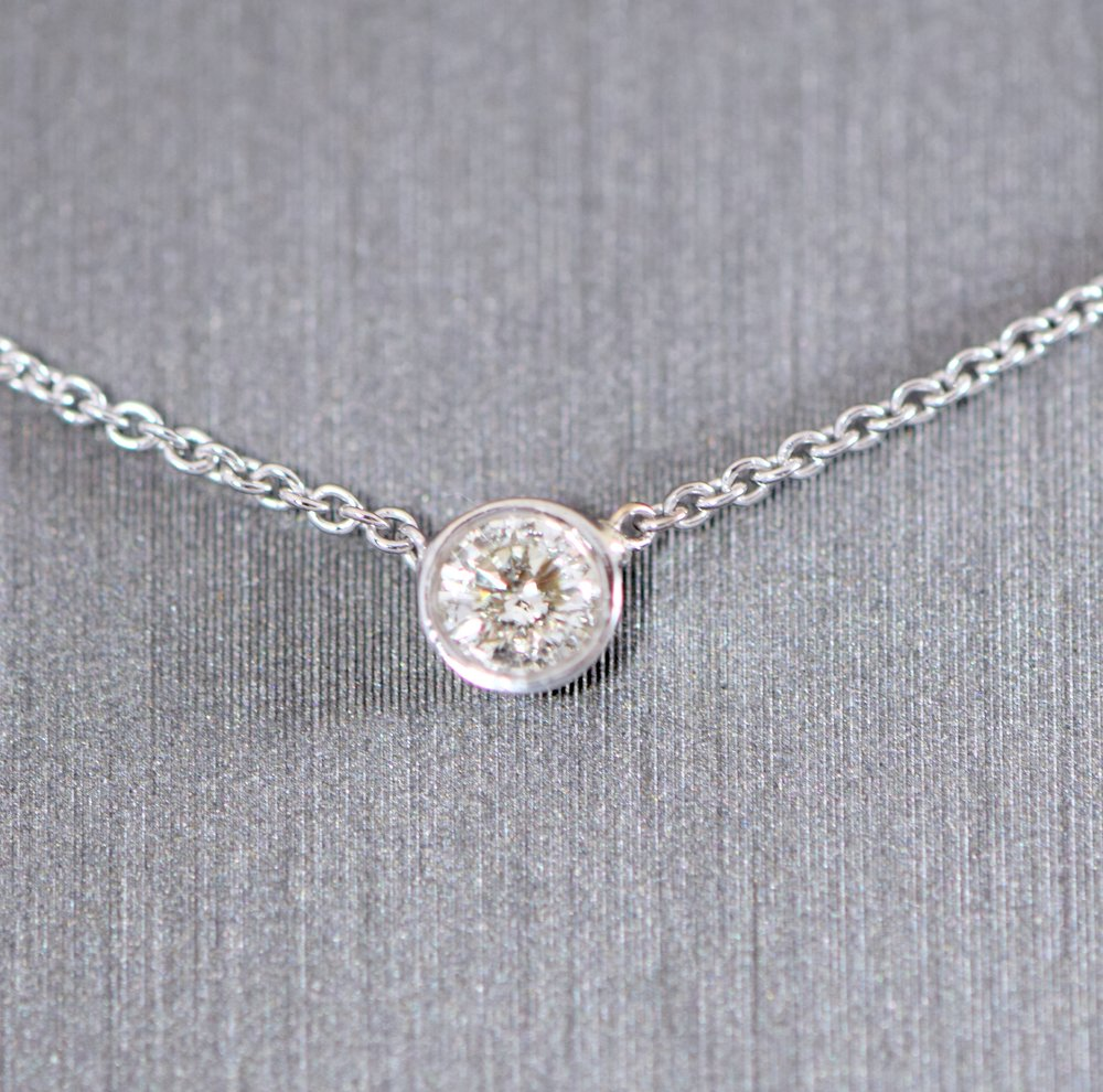 Single diamond pendant