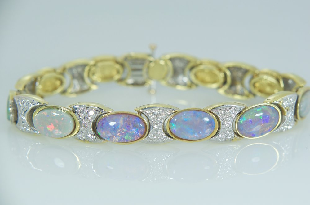 Black opal and diamond tennis bracelet