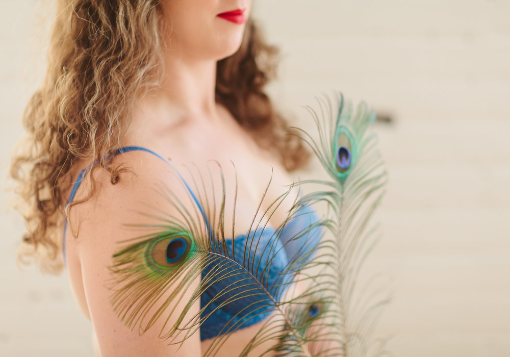 Accessories: V brought a few peacock feathers along to her session - we included them in just one picture, but this is so full of personality and feels natural, strong, and atmospheric.