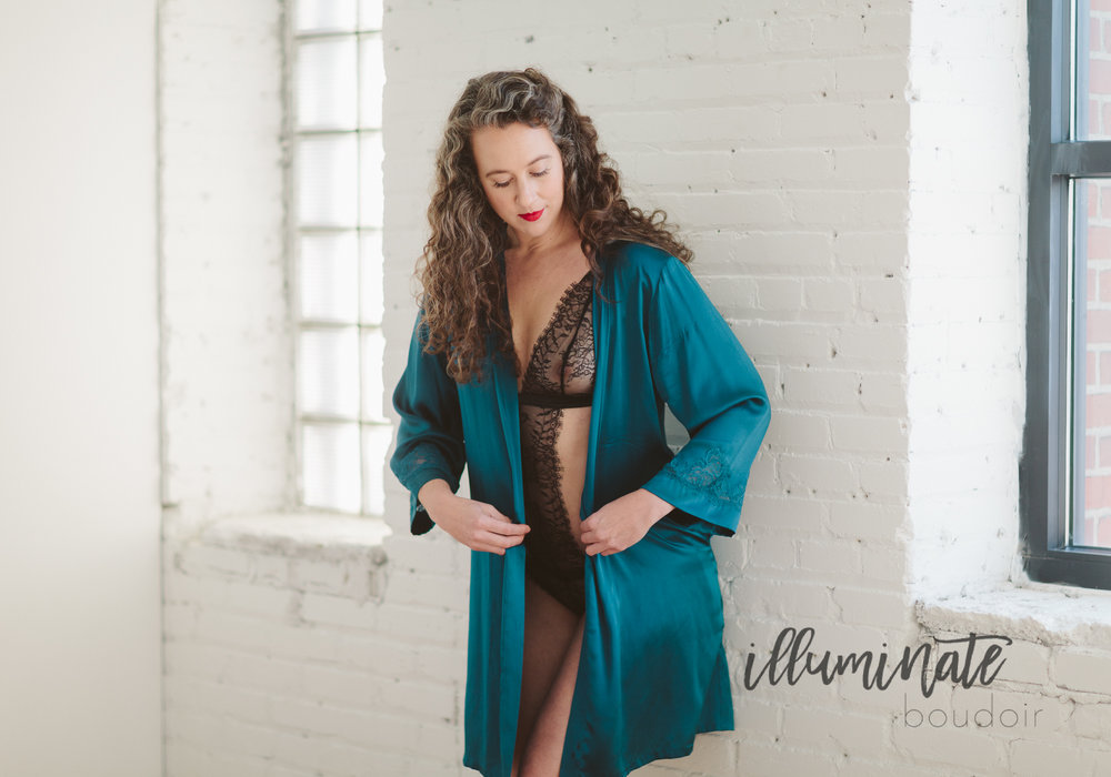 A silk robe offers more coverage for this lacy bodysuit, and also brings a ton of personality with this bold turquoise color!