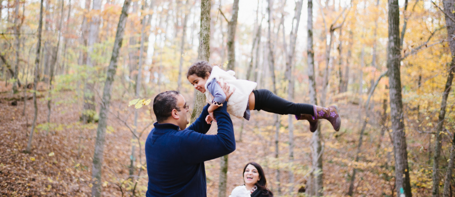 Bicester mum and dad explore the woods and play with their daughter during their family photography session.