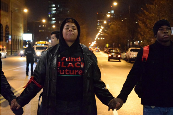 Activists joined hands at Roosevelt and Halsted before marching through the city streets November 24. (Martin Macias/City Bureau)