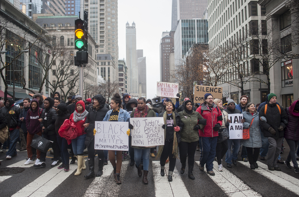 Protestors chants at the Magnificent Mile during Black Friday November 27, 2015 at a protest in memory of Laquan McDonald, backed by Reverend Jesse Jackson and other elected officials. Protest have been happening since the release of dash cam video of the killing of Laquan McDonald by Chicago Police officer Jason Van Dyke. (William Camargo)
