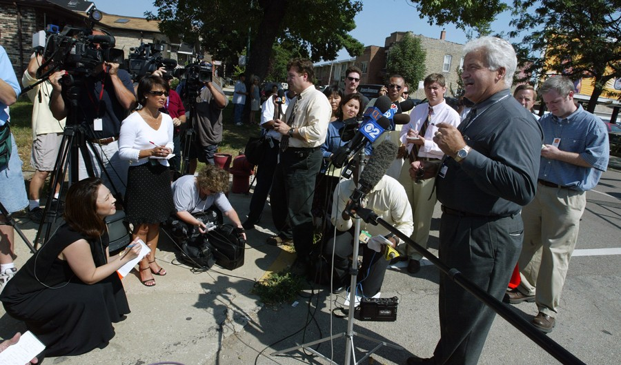 Camden, pictured in 2003 during his time as a CPD spokesman, has often been the only voice of authority talking to reporters immediately after a police shooting. (Tim Boyle/Getty Images)