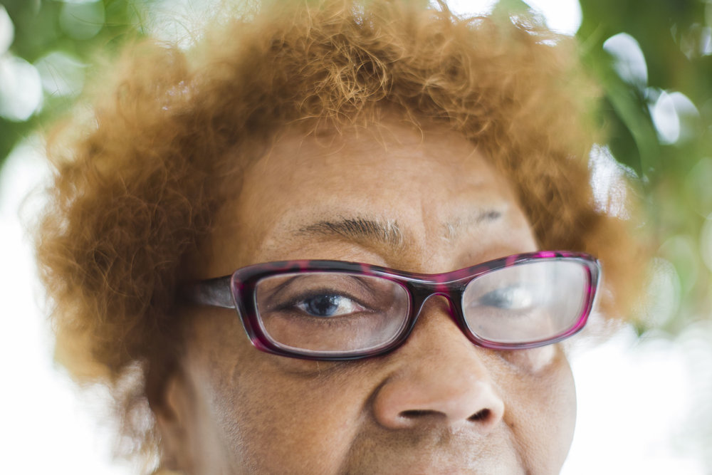 "Ruthie Doss, 72, has retinal degeneration and occasionally loses her visions temporarily. Doss enjoys living in a senior building in Washington Park, but she is concerned about the neighborhood. ""Even though fast food is not good for us, we should have something that we can just [walk] a block or half a block to…We have to travel a certain distance to get to everything."" Doss also talked about crime. ""I like to walk and now I got to be careful. I can't go out and walk like I want to…I'm a person that's not afraid though."""