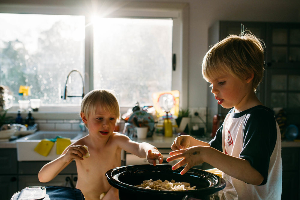 boys-helping-to-cook-together-in-kitchen
