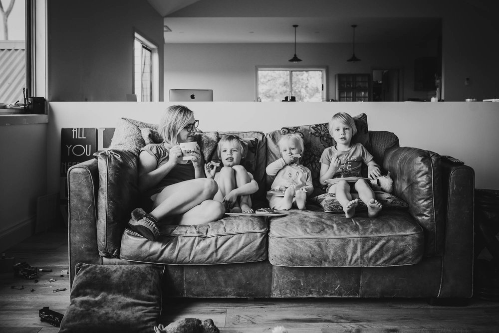 mom-having-breakfast-with-children-on-the-sofa