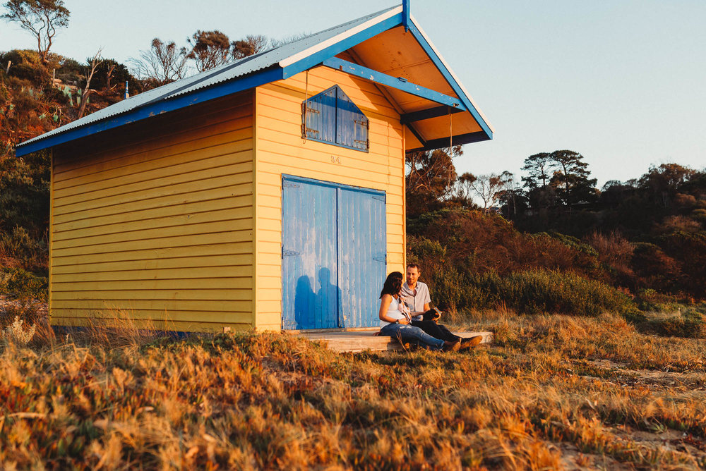 melbourne_maternity_photographer_jenny_rusby_photography_couple_sitting_together_at_the_beach_at_sunset