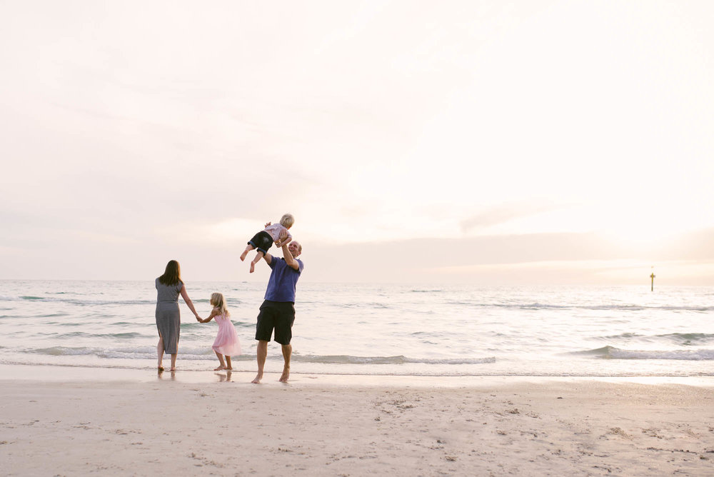 melbourne_family_photographer_family_playing_together_at_the_beach_at_sunset.jpg
