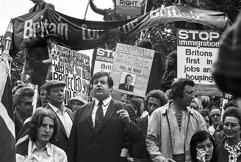 - In 1972 Idi Amin, the Present of Uganda at the time, gave the Asian population living in Uganda 90 days to leave the country. Many of these people had UK citizenship due to links to the British Empire and 27,200 people subsequently emigrated to the United Kingdom. Several right wing groups protested at the decision to allow these people to settle in the UK.This is a photo of Martin Webster from the National Front, speaking in 1972 at a meeting of Smithfield porters and National Front supporters. This meeting was before a march in support of Enoch Powell and in protest at the arrival of Ugandan Asians. The photo was taken on 7th September 1972© NLA/reportdigital.co.uk