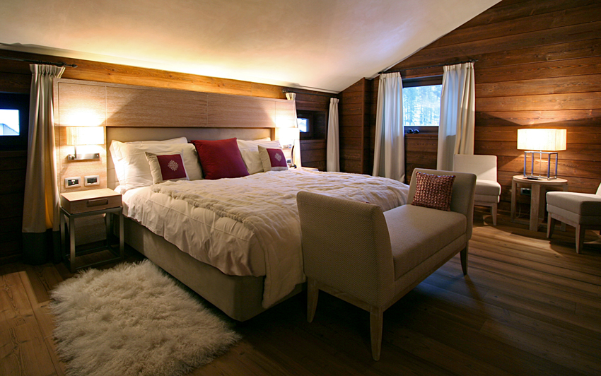 Guest Suite bedroom with wood paneling , custom designed headboard.