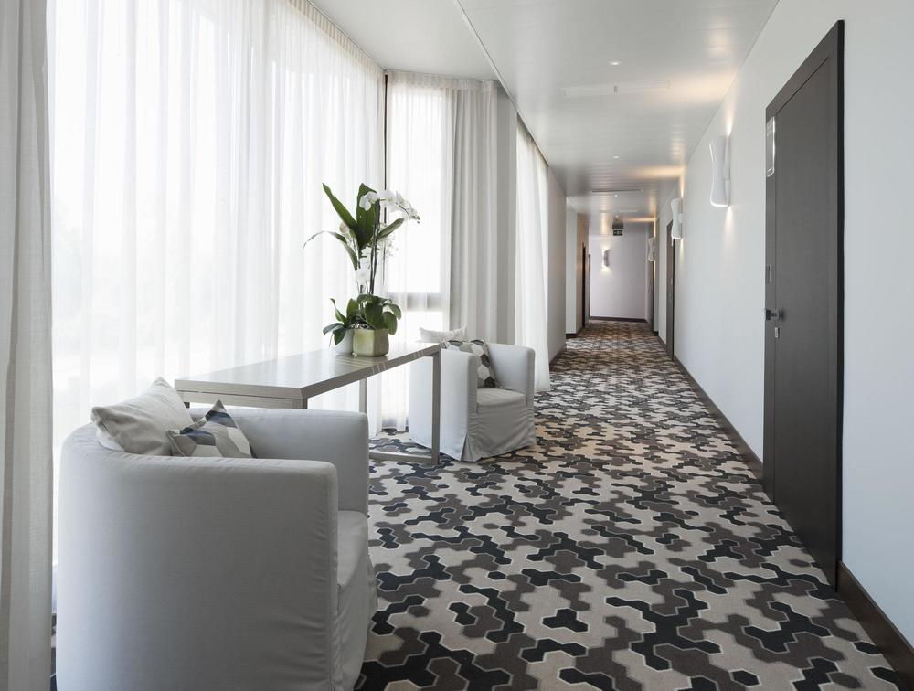Guest Corridor with carpets by Ege & custom furniture designed by THDP