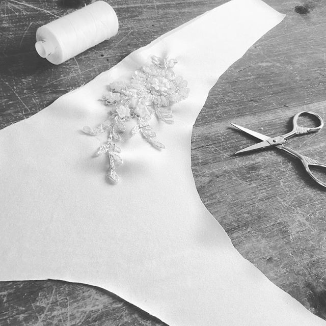 The start to the making of some beautiful ivory silk briefs with crystal embroidered lace motif placement, custom for a lovely #bridetobe - - - Our Easter gift you you... shop online at www.aemiliacouture.com with 30% off all products for a limited time only ||... - - - - - #sewing #behindthescenes #studio #inthestudio #lingerieset #flatlay #lacework #handmade  #handmadecrafts #lace #britishdesign #designerlingerie #luxurynightwear #productdevelopment #craftmanship #aemiliacouture #luxurylingerie #intimates #couture #classicstyle #beautifullingerie #handmade #madeinengland #giftsforher #bespoke #madetoorder #onlineboutique #customorder  #creativeprocess #silkandlace