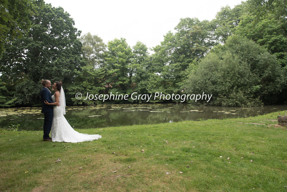 Laura and Ashley beside the lake in the grounds of Botleigh Grange Hotel, Southampton, Hampshire