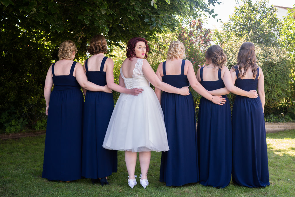Amy and her bridesmaids in the garden, beneath the tree before leaving for Hertford County Hall, Hertford Registration