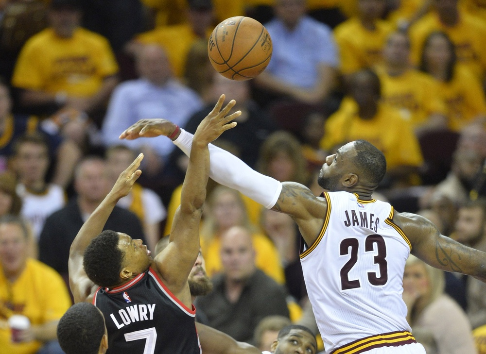 May 25, 2016; Cleveland, OH, USA; Cleveland Cavaliers forward LeBron James (23) blocks a shot by Toronto Raptors guard Kyle Lowry (7) in the third quarter in game five of the Eastern conference finals of the NBA Playoffs at Quicken Loans Arena. Mandatory Credit: David Richard-USA TODAY Sports