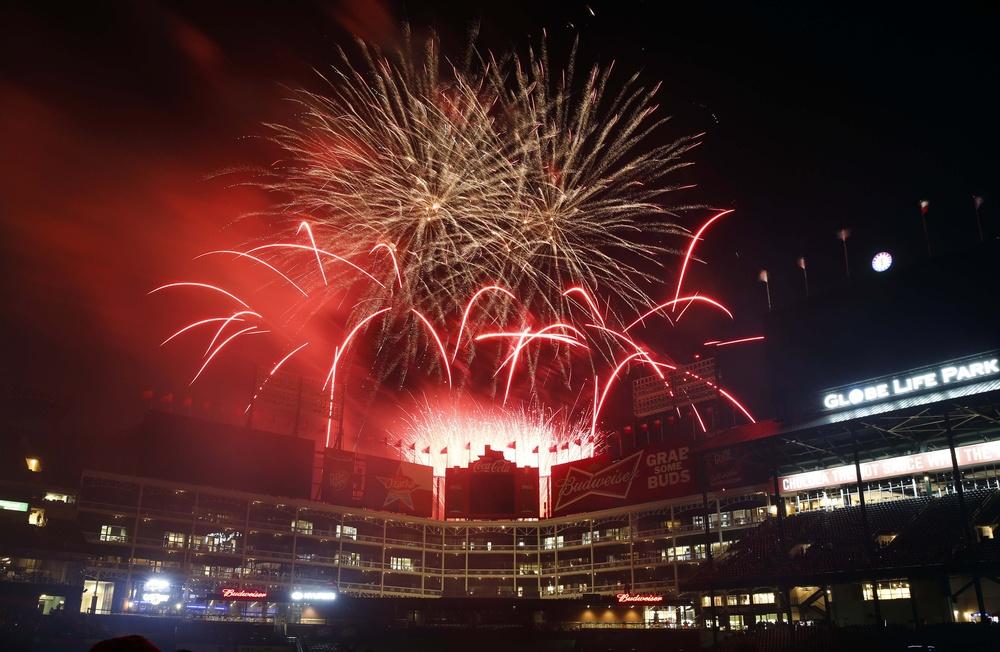 May 27, 2016; Arlington, TX, USA; Fireworks illuminate the sky following the baseball game between the Pittsburgh Pirates and the Texas Rangers at Globe Life Park in Arlington. Mandatory Credit: Jim Cowsert-USA TODAY Sports