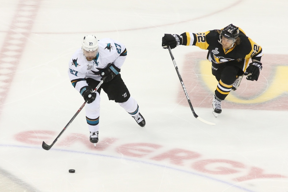 Jun 1, 2016; Pittsburgh, PA, USA; San Jose Sharks right wing Joonas Donskoi (27) skates with the puck against Pittsburgh Penguins left wing Carl Hagelin (62) in the third period of game two of the 2016 Stanley Cup Final at Consol Energy Center. Mandatory Credit: Charles LeClaire-USA TODAY Sports