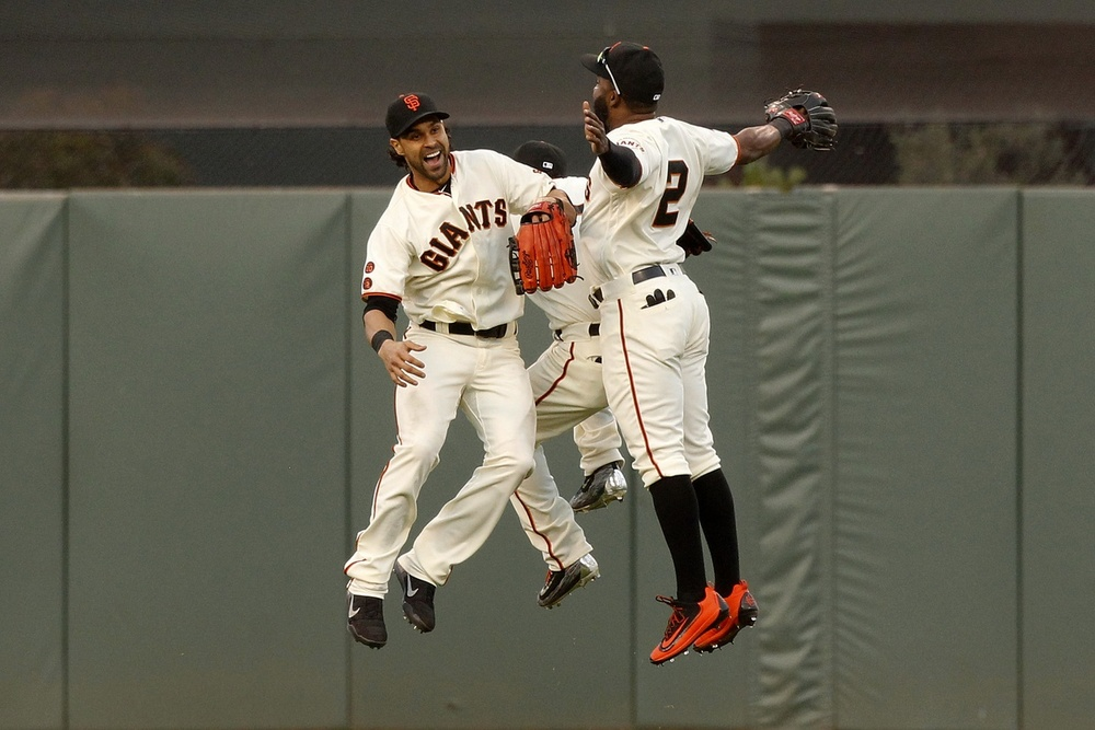 May 22, 2016; San Francisco, CA, USA; San Francisco Giants outfielder Angel Pagan (16) celebrates with outfielder Denard Span (2) and outfielder Gregor Blanco (7) after defeating the Chicago Cubs 1-0 at AT&T Park. Mandatory Credit: Cary Edmondson-USA TODAY Sports