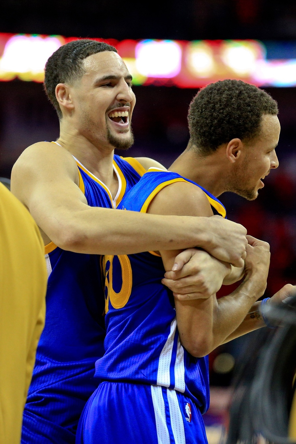 Apr 23, 2015; New Orleans, LA, USA; Golden State Warriors guard Stephen Curry (30) celebrates with guard Klay Thompson (11) following a win in overtime against the New Orleans Pelicans in game three of the first round of the NBA Playoffs at the Smoothie King Center. The Warriors defeated the Pelicans 123-119 in overtime. Mandatory Credit: Derick E. Hingle-USA TODAY Sports