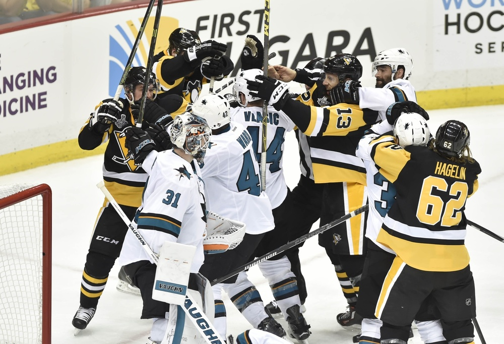 Jun 9, 2016; Pittsburgh, PA, USA; Pittsburgh Penguins and San Jose Sharks players scrum after a whistle in the third period game five of the 2016 Stanley Cup Final at Consol Energy Center. Mandatory Credit: Don Wright-USA TODAY Sports