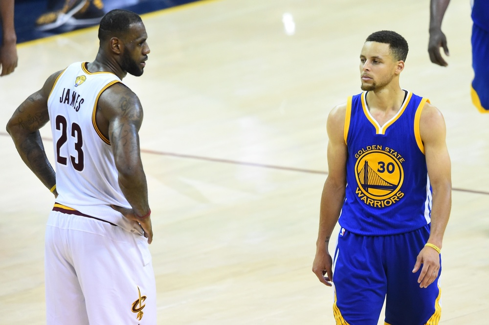 Jun 10, 2016; Cleveland, OH, USA; Cleveland Cavaliers forward LeBron James (23) and Golden State Warriors guard Stephen Curry (30) look on from the court during the fourth quarter in game four of the NBA Finals at Quicken Loans Arena. The Warriors won 108-97. Mandatory Credit: David Richard-USA TODAY Sports