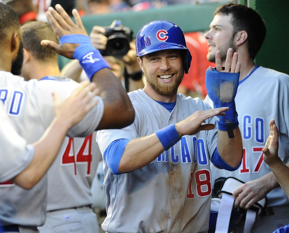 Jun 14, 2016; Washington, DC, USA; Chicago Cubs second baseman Ben Zobrist (18) celebrates with teammates after scoring a run against the Washington Nationals during the fourth inning at Nationals Park. Mandatory Credit: Brad Mills-USA TODAY Sports