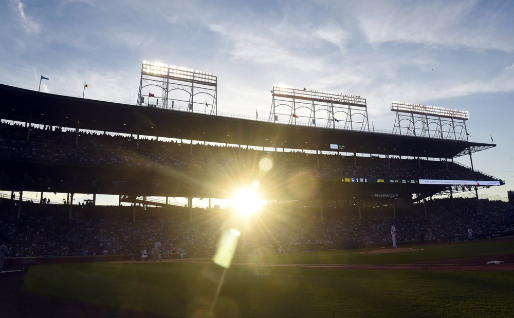 Jun 1, 2016; Chicago, IL, USA; The sun sets through the grandstands in a game between the Chicago Cubs and the Los Angeles Dodgers during the second inning at Wrigley Field. Mandatory Credit: David Banks-USA TODAY Sports