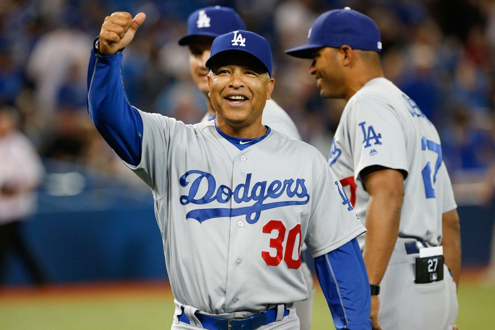 May 7, 2016; Toronto, Ontario, CAN; Los Angeles Dodgers manager Dave Roberts (30) gives the thumbs to LA Dodger fans after defeating the Toronto Blue Jays 6-2 at Rogers Centre. Mandatory Credit: Kevin Sousa-USA TODAY Sports